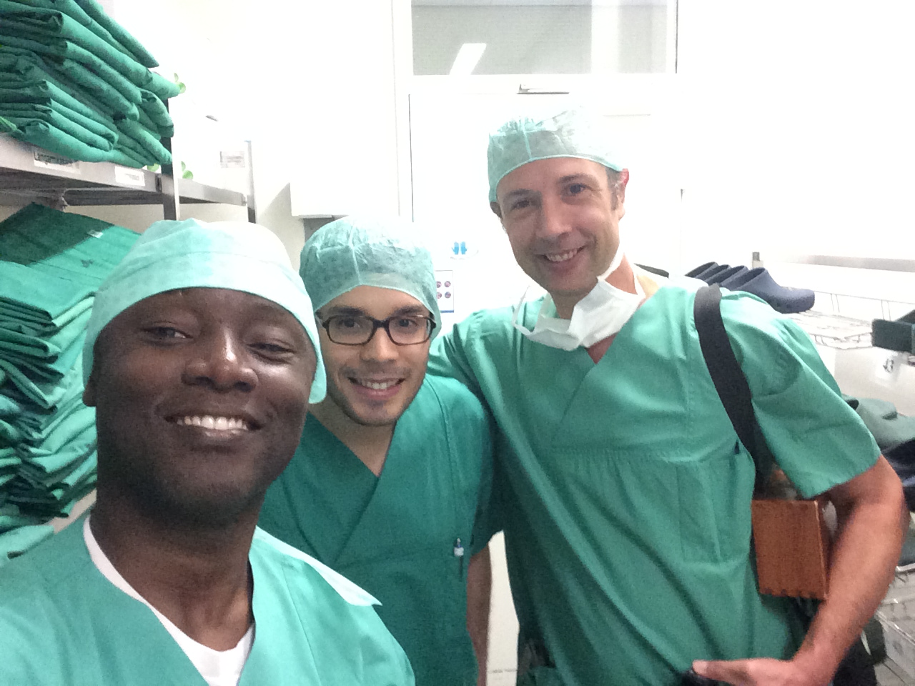 As part of FSS effort to build surgical capacity in Africa, Drs Boahene and Gassner have teamed up. Here the get ready to perform a gracilis flap to restore smile in a patient born with no smile muscles